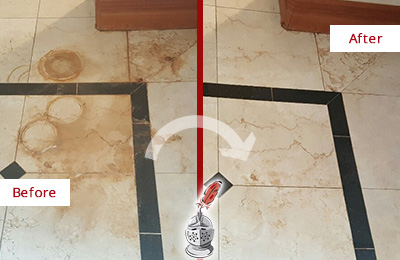 Before and After Picture of a Belmont Hard Surface Restoration Service on a Marble Floor to Eliminate Rust Stains
